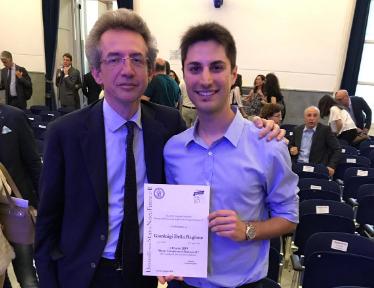 Gianluigi Della Ragione receiving award