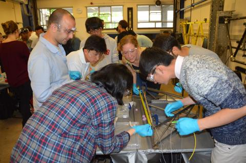 APESS 2016 students learning instrumentation during a demonstration in the lab.