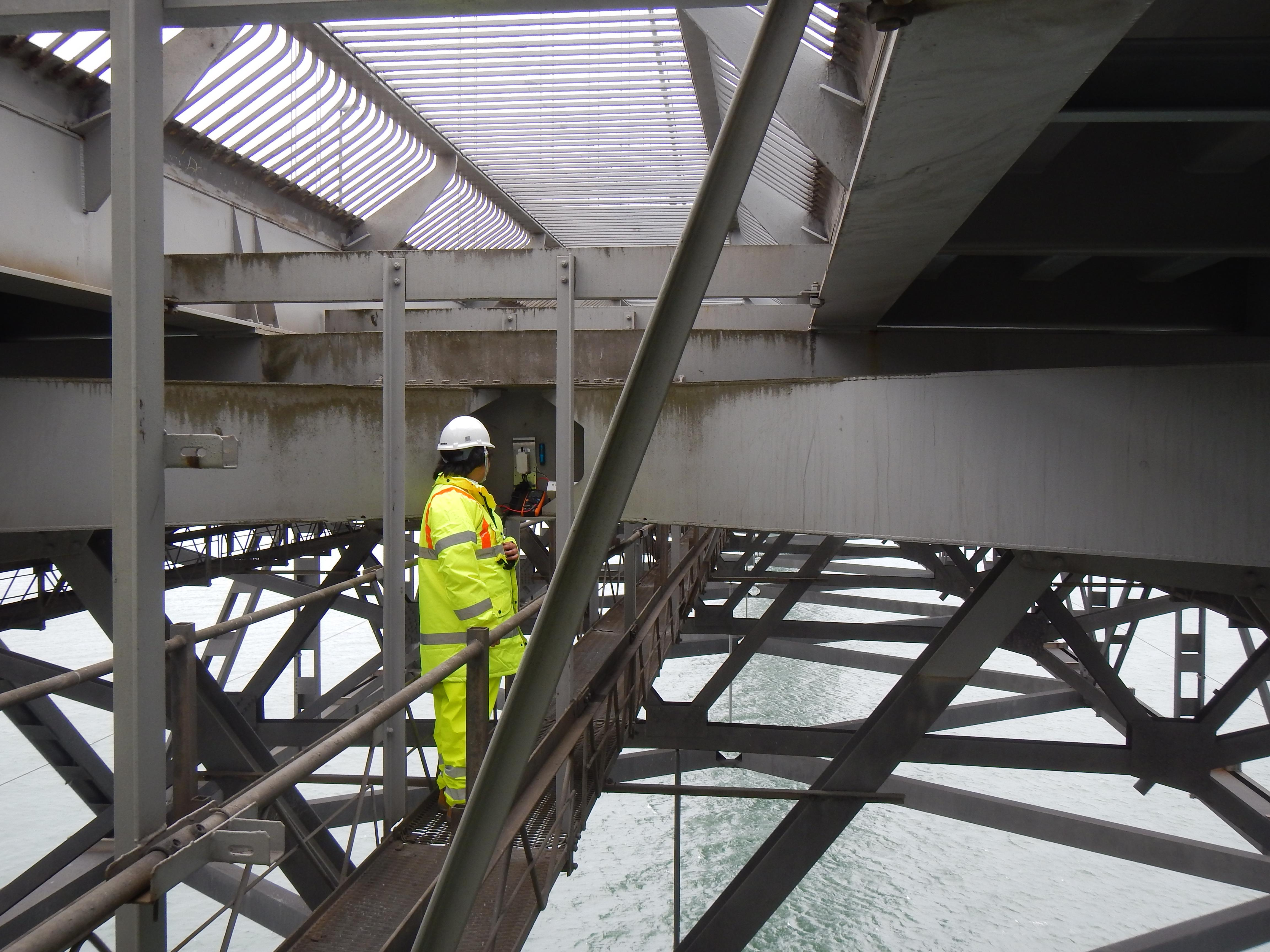 A CSIC vibration energy harvesting device being tested by Dr Yu Jia on the Forth Road Bridge